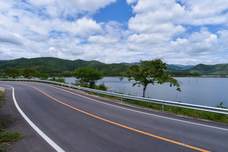 Curve Road in Thailand ,riverside and near mountain Stock Photo