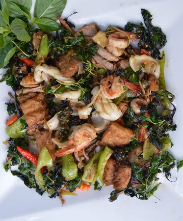 Stir fried crispy basil with pork seafood thai style photo
