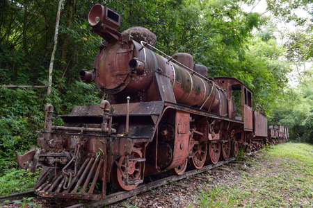 Rusty steam locomotive on WorldWar2 at Kanjanaburi Thailandv