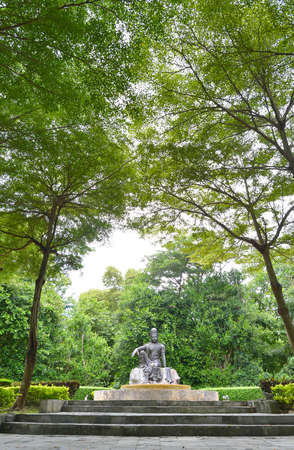 ratchaburi: old statue with the big tree in ratchaburi wax house Editorial