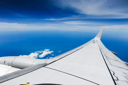 airfoil: Aircraft wing on the clouds,flying background