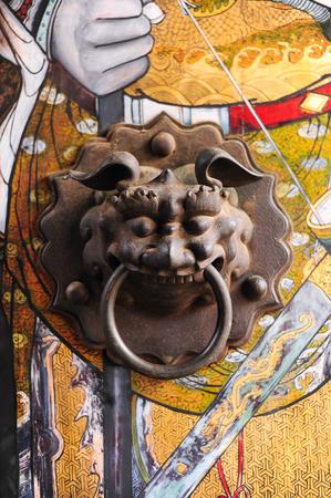 Chinese door with a lion hand door photo