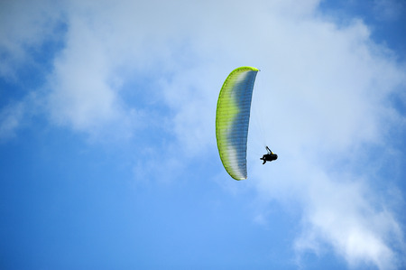 ail: Parasailing under blue sky