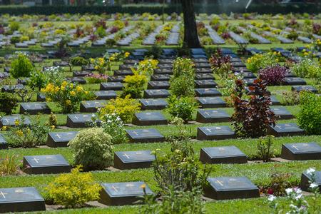 KANCHANABURI, THAILAND - SEPTEMBER 8 : Traveler foreigner visit Kanchanaburi War Cemetery (Don Rak) on September 8, 2014 in Kanchanaburi Thailand.