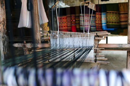 oldstyle: Old-style loom producing a cloth Stock Photo