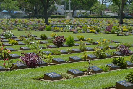 foreigner: KANCHANABURI, THAILAND - SEPTEMBER 8 : Traveler foreigner visit Kanchanaburi War Cemetery (Don Rak) on September 8, 2014 in Kanchanaburi Thailand.
