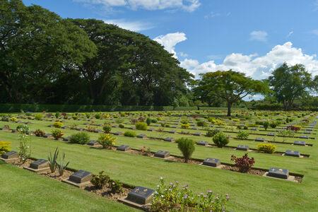 foreigner: KANCHANABURI, THAILAND - SEPTEMBER 8 : Traveler foreigner visit Kanchanaburi War Cemetery (Chong Kai) on September 8, 2014 in Kanchanaburi Thailand. Editorial