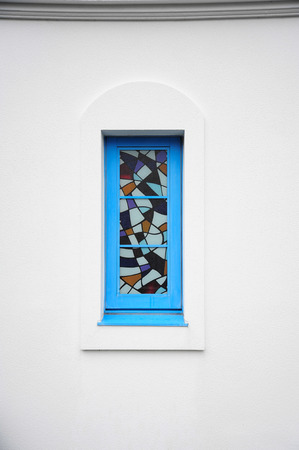 latticed: Arched latticed window in a white church wall Stock Photo