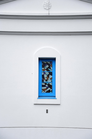 arched: Arched latticed window in a white church wall Stock Photo