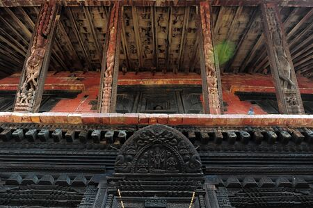 going places: BHAKTAPUR, NEPAL-FEBRUARY 17, 2015: Elements of carved art on a Durbar square of Bhaktapur on February 17, 2015. Bhaktapur is a cultural gem in Nepal
