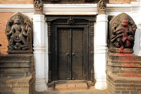 closed society: BBHAKTAPUR NEPALFEBRUARY 17 2015: Elements of carved art on a Durbar square of Bhaktapur on February 17 2015. Bhaktapur is a cultural gem in Nepal