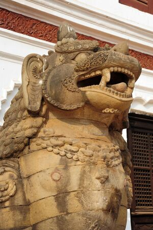 closed community: BHAKTAPUR, NEPAL-FEBRUARY 17, 2015: Elements of carved art on a Durbar square of Bhaktapur on February 17, 2015. Bhaktapur is a cultural gem in Nepal