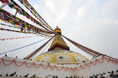 KATHMANDU NEPAL FEBRUARY 23: Surroundings around Boudhanath stupa on February 23 2015 Kathmandu Nepal. Boudhanath is a UNESCO World Heritage Site one of the most popular tourist sites in Kathmandu.