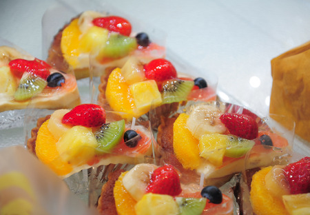 Pastry shop with fruit cake photo