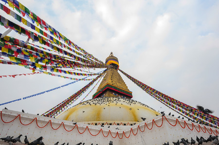 KATHMANDUNEPALFEBRUARY 23: Surroundings around Boudhanath stupa on February 23 2015 Kathmandu Nepal. Boudhanath is a UNESCO World Heritage Site one of the most popular tourist sites in Kathmandu.