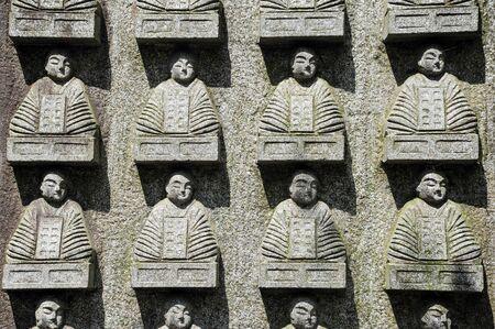 statuettes: Jizo statuettes on wall
