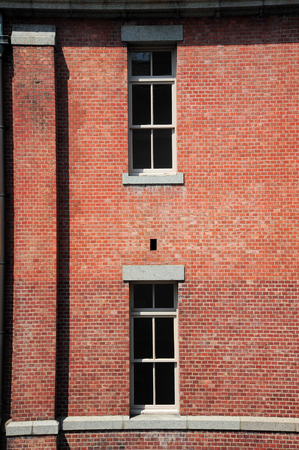 brick building: Old red brick building or factory with many small windows