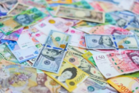 Blurred Multi International Currency for Background Stock Photo