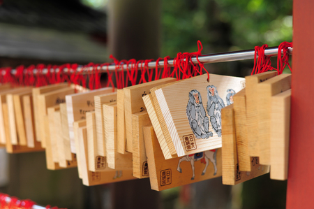 three wishes: NIKKO, JAPAN - OCTOBER 6,Wooden plate of Three wise monkey in Toshogu shrine Nikko, Japan on October 6, 2015. Shrine visitors write their wishes on wood plates and leave them inside the Toshogu shrine in the hope that their wishes come true.