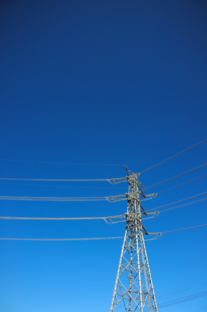megawatt: High voltage post or High voltage tower with blue sky background Stock Photo