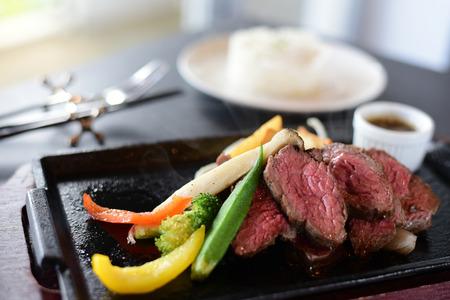 Medium rare wagyu steak with rice on table