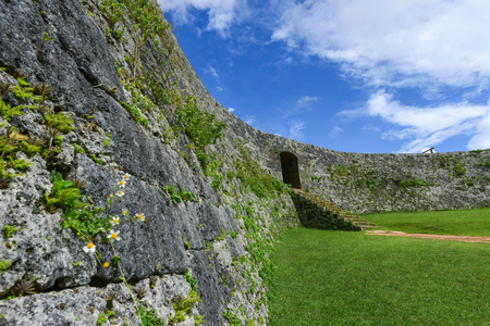 Zakimi Castle is a Ryukyuan gusuku in Yomitan, Okinawa. It is in ruins, but the walls and foundations have been restored. It was built between 1416 and 1422 by the renowned Ryukyuan general Gosamaru Stock Photo