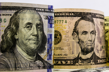 American dollars cash money. background from US dollars. different banknotes. top view Banco de Imagens
