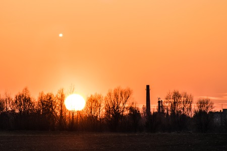 sunset over the industrial zone, moon