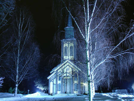 church in Honefoss, Norway on a winter night
