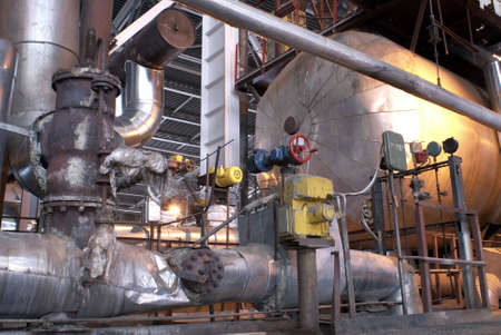 fabricate: Equipment, cables and piping as found inside of a modern industrial power plant. Stock Photo