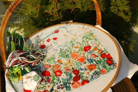 needlework of generic flowers on textile (cross stitch) Stock Photo