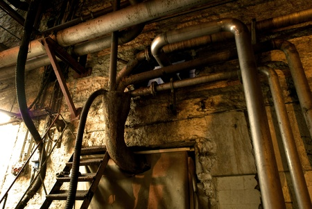 Old abandoned dirty empty scary factory interior Stock Photo