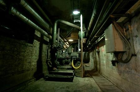 Old abandoned dirty empty scary factory interior Zdjęcie Seryjne