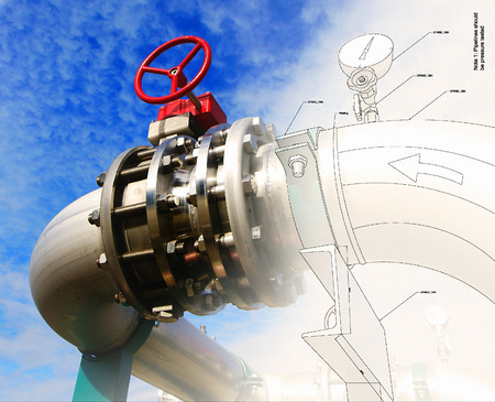 Steel pipelines and valves against blue sky Standard-Bild