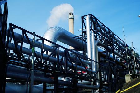 Industrial Steel pipelines and valves  against sky 写真素材