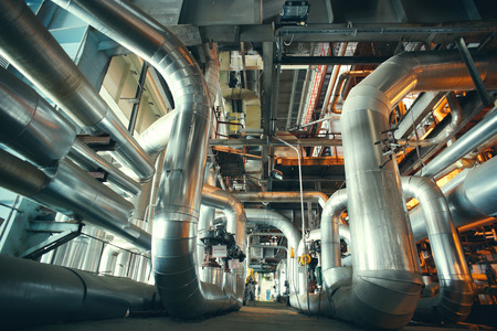 different size and shaped pipes and valves at a power plant