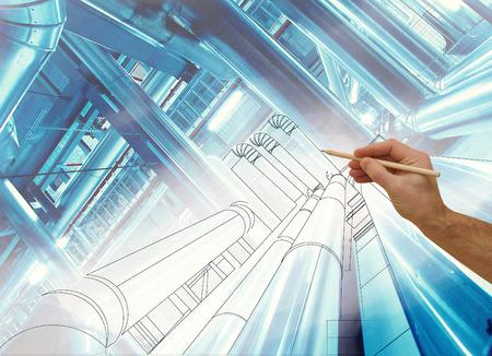 男の手が現代産業発電所の写真と組み合わせる工場のデザインを描画します