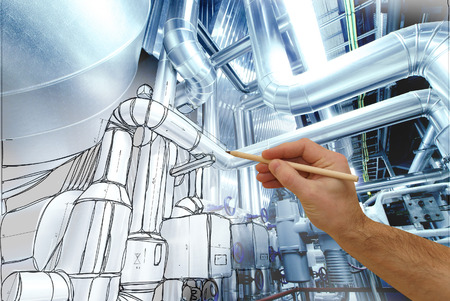 mans hand draws a design of factory combined with photo of modern industrial power plant