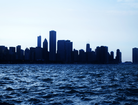 Chicago city downtown urban skyline at dusk with skyscrapers over Lake Michigan with clear blue sky. Usa