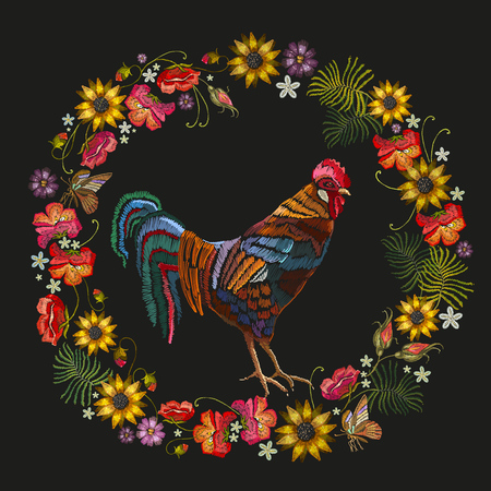 Embroidery of rooster with wreath of flowers.