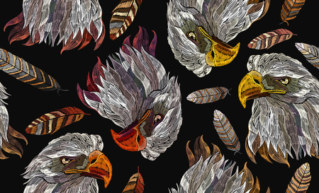 Embroidery head eagle and feather seamless pattern Template for clothes, textiles, t-shirt design. Classical embroidery hawk head