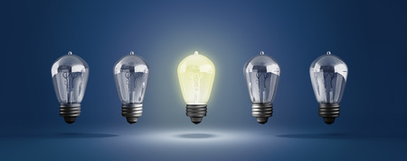Idea concept with row of light bulbs and glowing bulb 3d illustration on blue Stock Photo