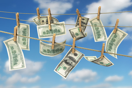 concept of money laundering dollar money bills on rope 3d render on sky background Stock Photo