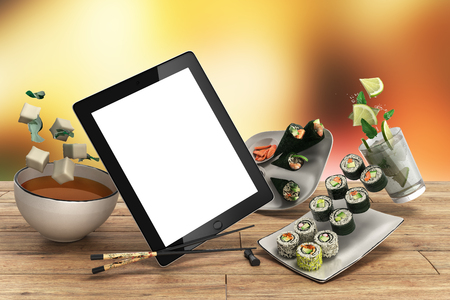 chop sticks: Online Japanese food delivery concept with sushi rolls on an electronic tablet and chopsticks 3d illustration Stock Photo