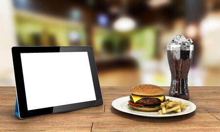 Tablette avec un écran vide sur la table en bois avec un hamburger et un verre de cola avec de la glace Espace libre pour le rendu 3d de texte