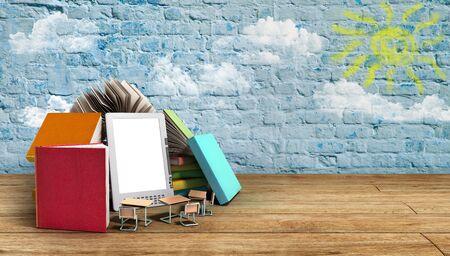 flor: E-book reader Books and tablet 3d render image on wood flor Success knowlege concept Stock Photo