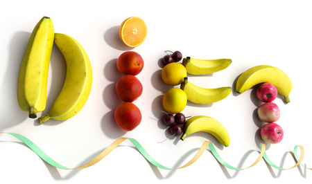 white plate with laid out on her word diet composed of slices of different fruits 3d render