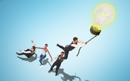 Concept of a successful team idea A light bulb that pulls people up 3d render on blue
