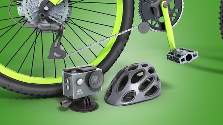 the concept of extreme sports action camera bicycle helmet and bicycle 3d render on a green background