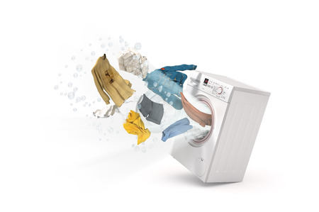 Washing machine and flying clothes on white background Standard-Bild